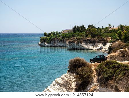 A four wheel drive car dangerously parked next to steep cliff at Governor's beach between Larnaca and Limassol Cyprus