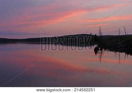 Pink Reflections at Twilight on LIttle Saganaga Lake in the Boundary Waters in Minnesota