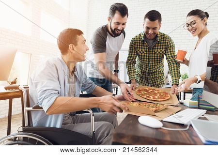 The office workers decided to take a break. They decided to have dinner pizza. They smile and have a conversation.