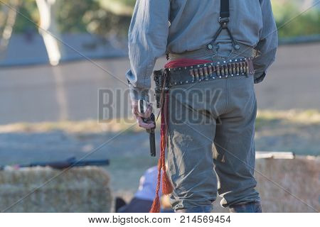 Participant With Scenographic Gun During Tumbleweed Festival