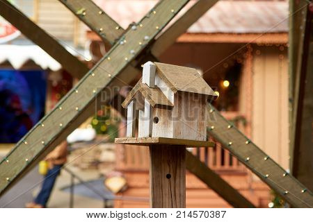 Small Bird house with beams behind outside