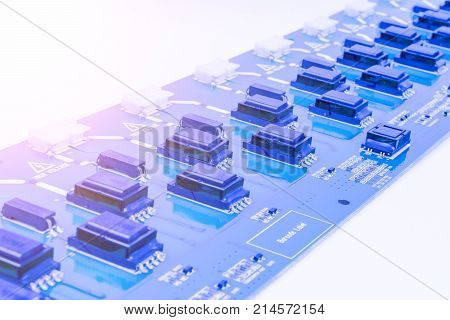 Circuitboard with resistors microchips and electronic components. Electronic computer hardware technology. Integrated communication processor. Information engineering component. Semiconductor. PCB.