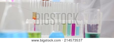 Chemical industry bulb with blue magenta pink liquid lab tubes stand on the table in the laboratory of liquid testing test development substances poisons additives stabilizers flavors house cleaning.