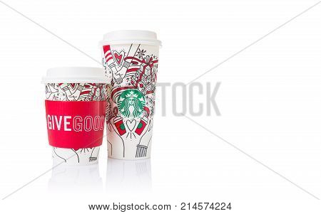 Chiang Mai Thailand- 18 November 2017 - 2 sizes Grande and Venti of Starbucks Coffee paper cups in beautiful 2017 Christmas design and red hot cup holder in white Give Good text display on white background in Chiang Mai Thailand on November 18 2017