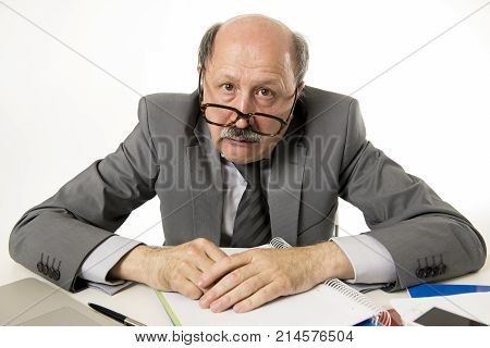 senior mature busy business man with bald head on his 60s working stressed and frustrated at office computer desk looking tired and overwhelmed in job problems and overwork concept