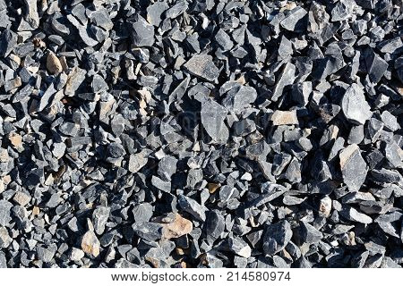 Black limestone rubbles for construction as background or texture. poster