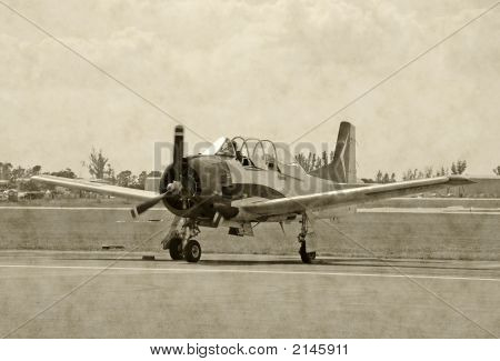Black and white photograph of classic wartime airplane poster