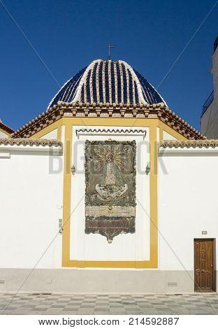 BENIDORM, COSTA BLANCA, SPAIN, 11TH JANARY 2017 - Plaque on the external wall of the church of San Jaime and Santa Ana Benidorm Alicante Spain