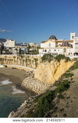 BENIDORM, COSTA BLANCA, SPAIN, 11TH JANARY 2017 - Old Town beach and Church of San Jaime and Santa Ana Benidorm Alicante Spain