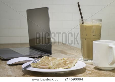 Easy meal in work hour with coffee drink and fried roti stock photo