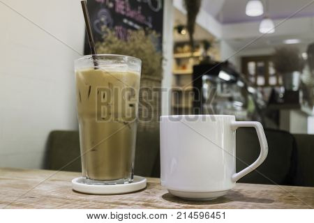 Hot coffee and iced coffee on wooden table stock photo