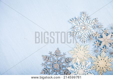 Silvery Snowflakes On A Blue  Background