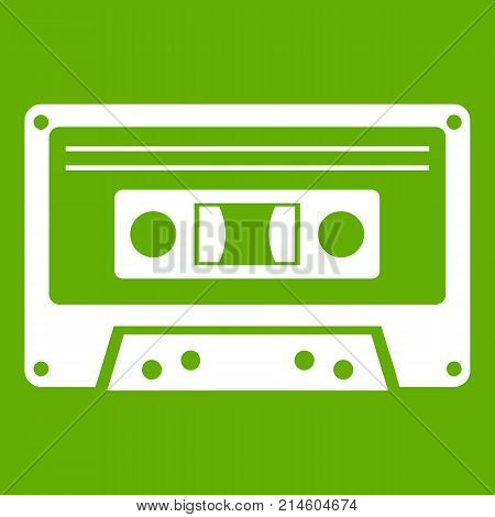 Cassette tape icon white isolated on green background. Vector illustration