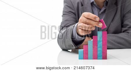 Businessman Building A Staircase With Wood Blocks