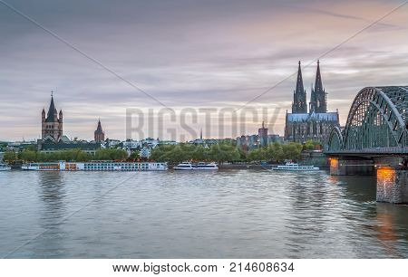 View of Historic center of Cologne with Hohenzollern Bridge from Rhein river Germany