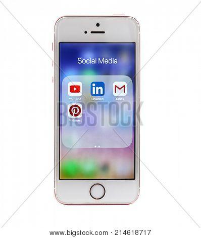 KIEV, UKRAINE - OCTOBER 6, 2017: Social media icons on screen of Rose Gold iPhone SE, isolated on white
