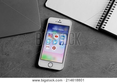 KIEV, UKRAINE - OCTOBER 02, 2017: Rose gold iPhone SE with social media icons on screen