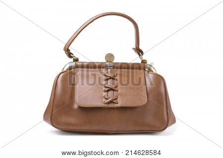 an old brown leatherette purse on a white background