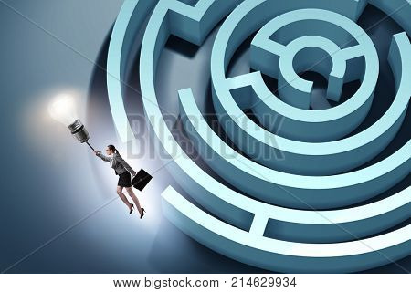 Businesswoman escaping from maze on balloon