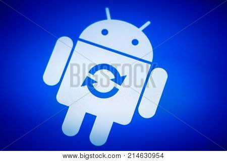 Moscow, Russia - October 1, 2017: Android robot logo icon on the smart phone screen during update installation