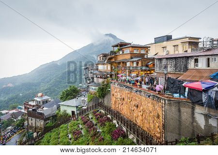 Jiufen Taiwan - November 9 2017: Jiufen historical township in north part of Taiwan on cloudy day surrounded by mountains.
