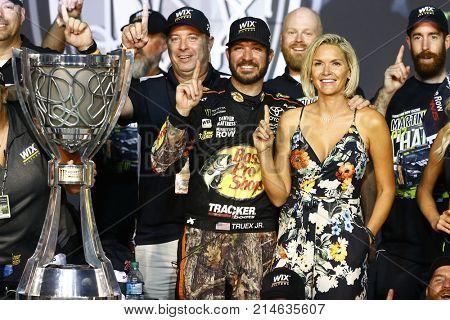 November 19, 2017 - Homestead, Florida, USA: Martin Truex Jr (78) and his crew celebrate winning the Championship after winning the Ford EcoBoost 400 at Homestead-Miami Speedway in Homestead, Florida.