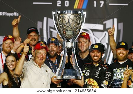 November 19, 2017 - Homestead, Florida, USA: Martin Truex Jr (78) and his crew celebrate winning the Championship after winning the Ford EcoBoost 400 at Homestead-Miami Speedway in Homestead, Florida.