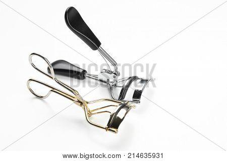Eyelash curlers on white background