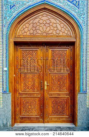 Ornate wooden door on Iranian Mosque in Bur Dubai