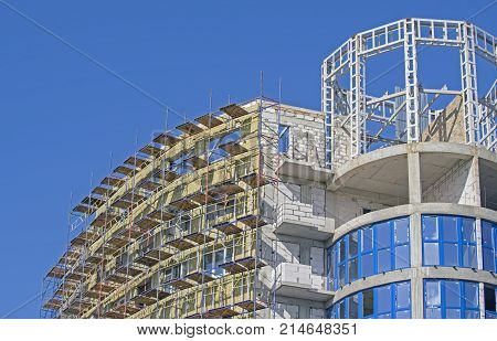 building under construction against the blue sky