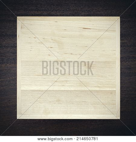 White wooden box on dark texture background