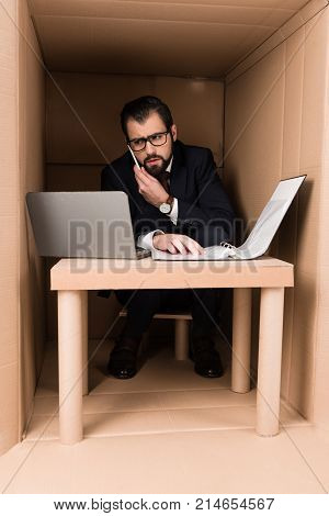 Businessman With Documents And Laptop