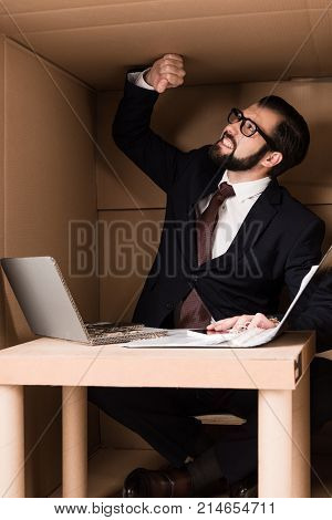 Businessman Working With Cardboard Laptop