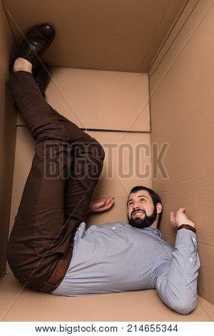 Depressed Man In Cardboard Box