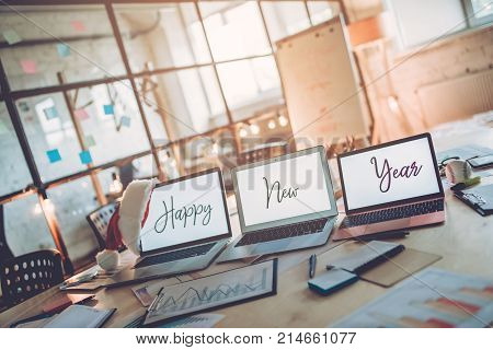 Merry Christmas and Happy New Year 2018! Celebrating holiday in modern office. Last working day.