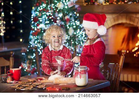 Child Baking Christmas Cookies. Kids Bake For Xmas