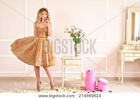 Happy Blonde Girl In A Beige Dress. Baby Doll Delicate Style. Soft Portrait Look