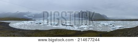 Wide panoramic view of icebergs in Glacier Lagoon Iceland