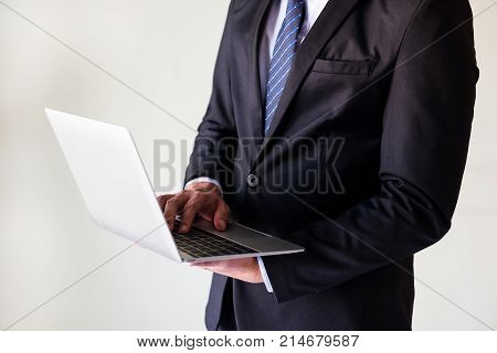 Businessman Working On Laptop With Copy Space