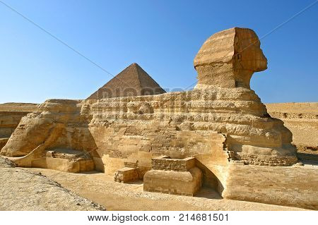 Great Sphinx of Giza profile with pyramid of Khafre in the background - Cairo, Egypt