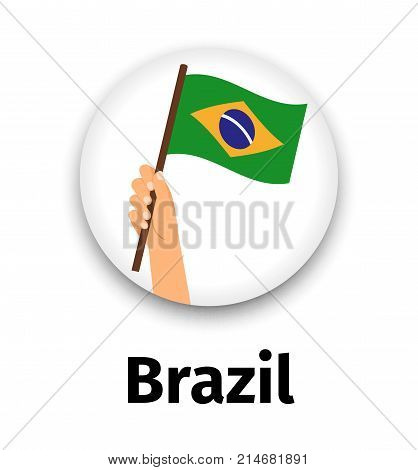 Brazil flag in hand, round icon with shadow isolated on white. Human hand holding flag, vector illustration