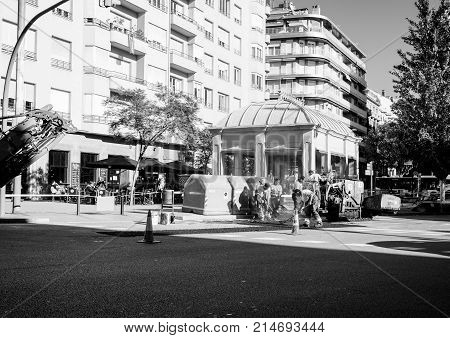 BARCELONA SPAIN - NOV 12 2017: Workers posing asphalt on the street of Barcelona on the Via Augusta street ona warm autumn day