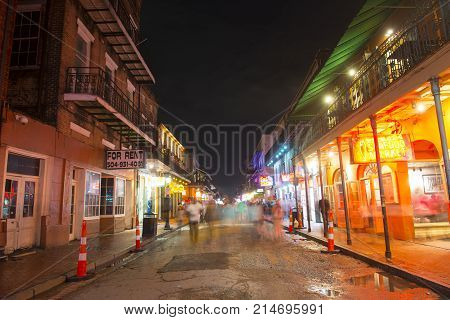 NEW ORLEANS - JUN. 1, 2017: Historic Buildings on Bourbon Street between Conti Street and St Louis Street in French Quarter at night in New Orleans, Louisiana, USA.