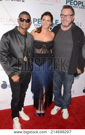 LOS ANGELES - NOV 13:  Usher Raymond IV, Kaily Smith Westbrook, Tom Arnold at the