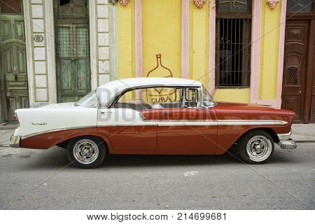 HAVANA, CUBA - 16 FEB, 2017. Red vintage classic American car, commonly used as private taxi parked in Old Havana street.