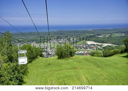 COLLINGWOOD, ON, CANADA - JULY 20, 2017: View of gondola chairlift on top of Blue Mountain Ski Resort during summer time