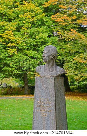 Autumn in central park - art gardener and botanist Vaclav Skalnik´s bust in Marianske Lazne (Marienbad) - great famous Bohemian spa town in the west part of the Czech Republic (region Karlovy Vary)