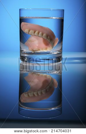 denture in a glass of water