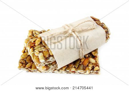 nuts and honey bar isolated on white