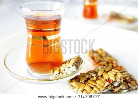Turkish hot tea in traditional glasses .
